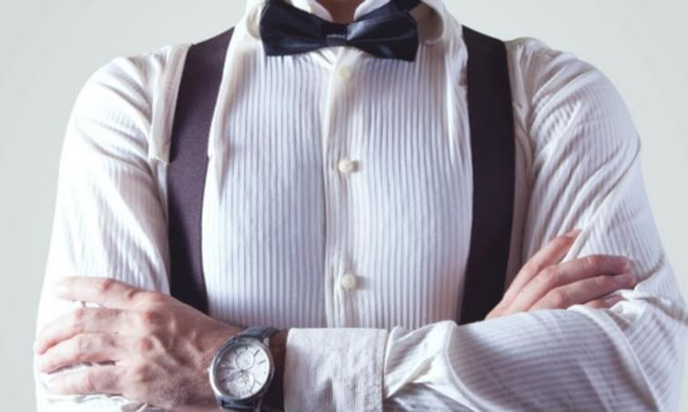 Arms Crossed with bow tie and suspenders - net2phone Canada - Business VoIP Phone System