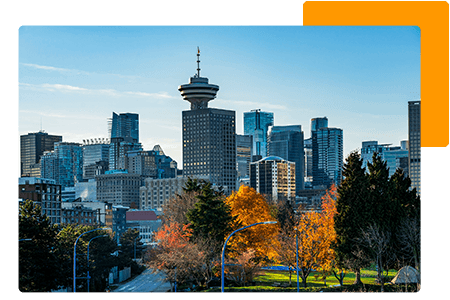Skyline of British Columbia business buildings behind trees - net2phone Canada - Business VoIP Phone System