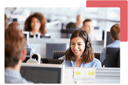 Woman talking into headset at call centre surrounded by employees - net2phone Canada - Business VoIP Phone System
