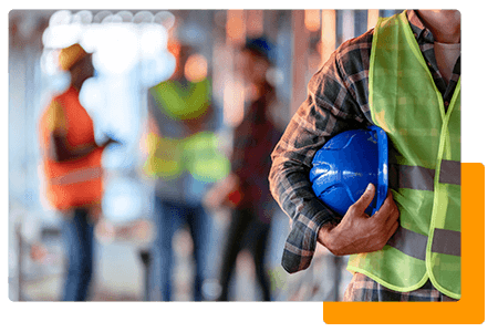 Construction worker holding blue hard hat - net2phone Canada - Business VoIP Phone System