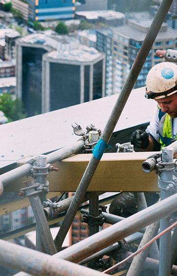 Construction worker on scaffold - D Grant Case Study- net2phone Canada - Business VoIP Phone System