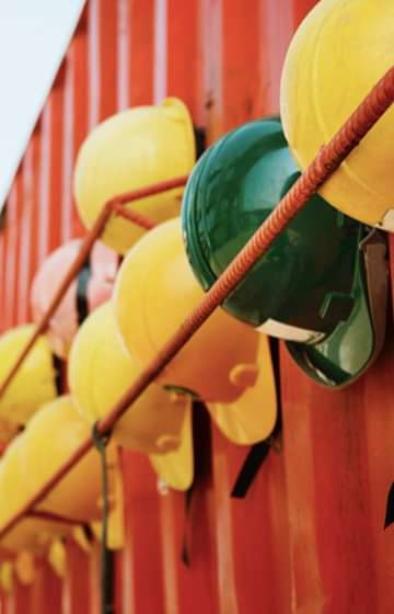 Yellow & Green Construction Hard Hats - net2phone Canada - Business VoIP Phone System