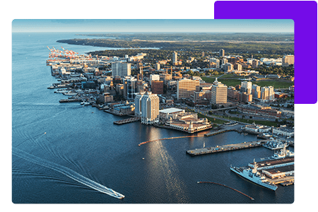 maritimes waterfront cityscape with boat gliding through water