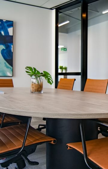 Conference Table with leather chairs - Naidu Legal Law Firm Lawyers - net2phone Canada - Business VoIP Phone System