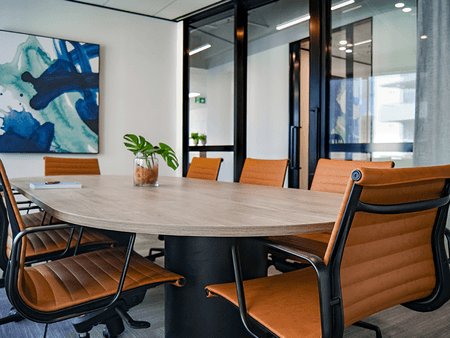 Naidu Legal - Big conference table with leather chairs and blue painting - net2phone Canada - Business VoIP Phone System