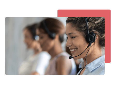 woman working at a call centre wearing headset smiling - net2phone Canada - Business VoIP Phone System