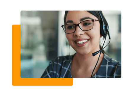 woman wearing glasses and headset smiling - net2phone Canada - Business VoIP Phone System