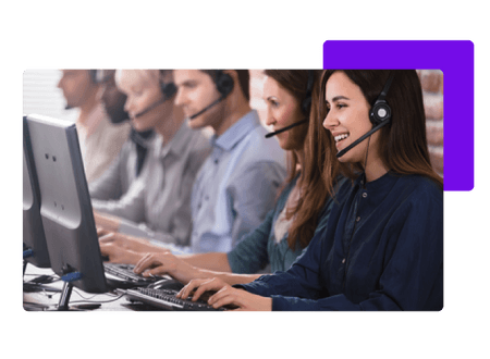 Call centre employees talking into headsets and typing into computers - net2phone Canada - Business VoIP Phone System