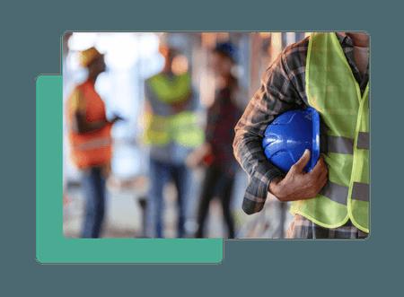 Construction worker holding helmet