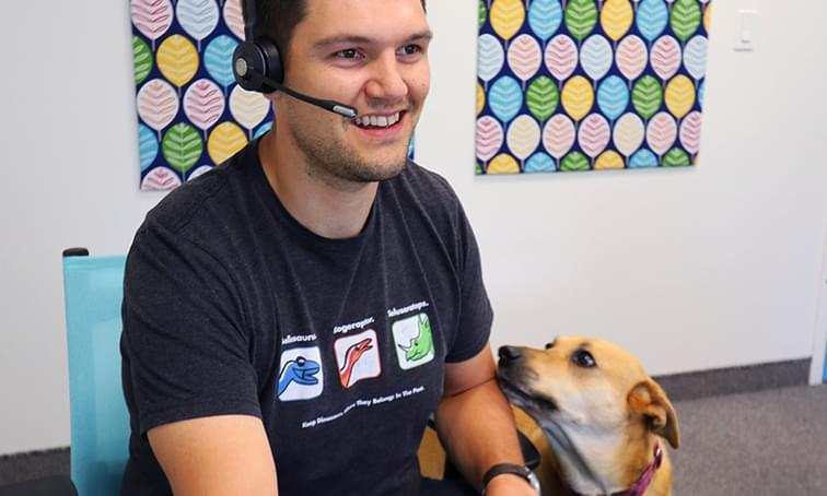 net2phone canada employee smiling talking on a headset