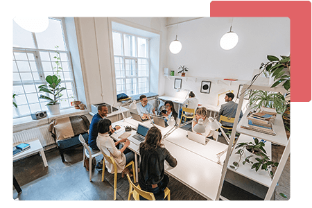 group of employees meeting in open concept working space