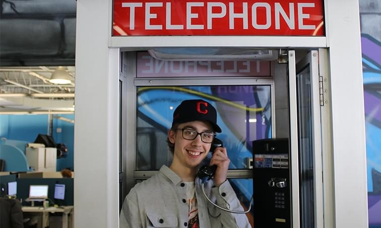 net2phone canada employee in a phone booth