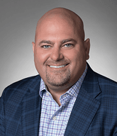 Headshot of Tim Brien, Sales Director - net2phone Canada - Business VoIP Phone System