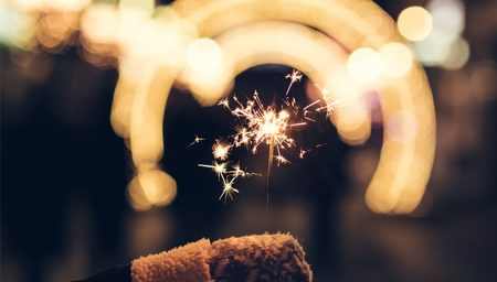 Sparkler held by a child with a glove on - net2phone Canada - Business VoIP Phone System