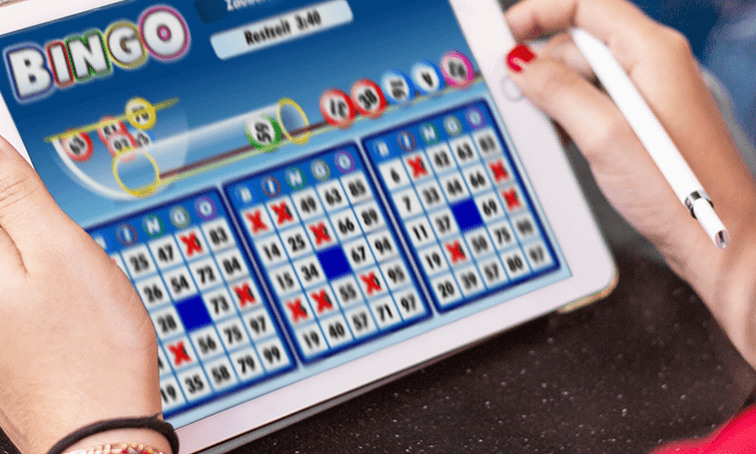 Bingo on ipad held by woman - net2phone Canada - Business VoIP Phone System