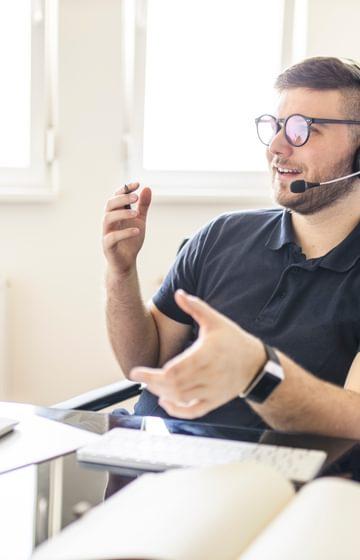 A man talking on a headset
