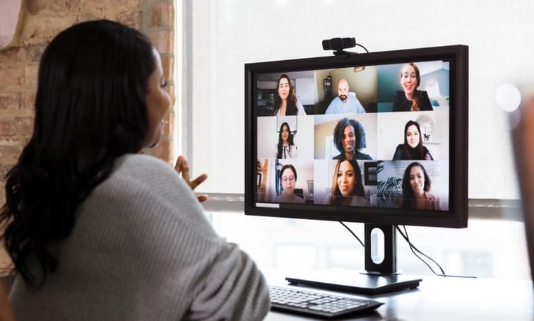 Woman speaking in a virtual video conference - computer conference - net2phone Canada - Business VoIP Phone System