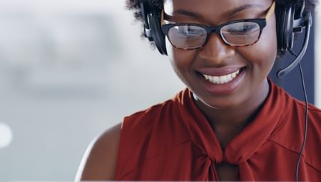 Smiling woman on a headset