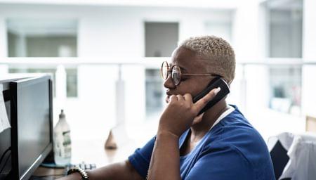 Woman on desk phone