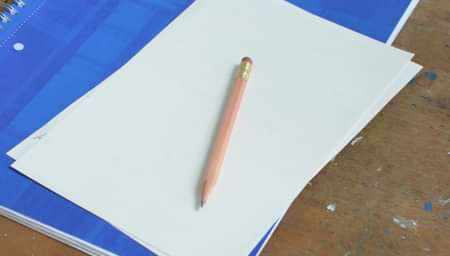 Notebook with paper and a pencil