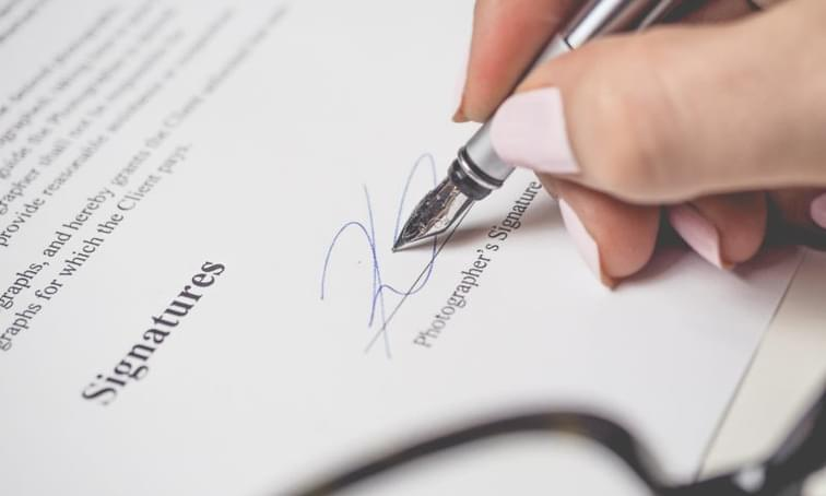 Signing a contract with a fountain pen - net2phone Canada - Business VoIP Phone System