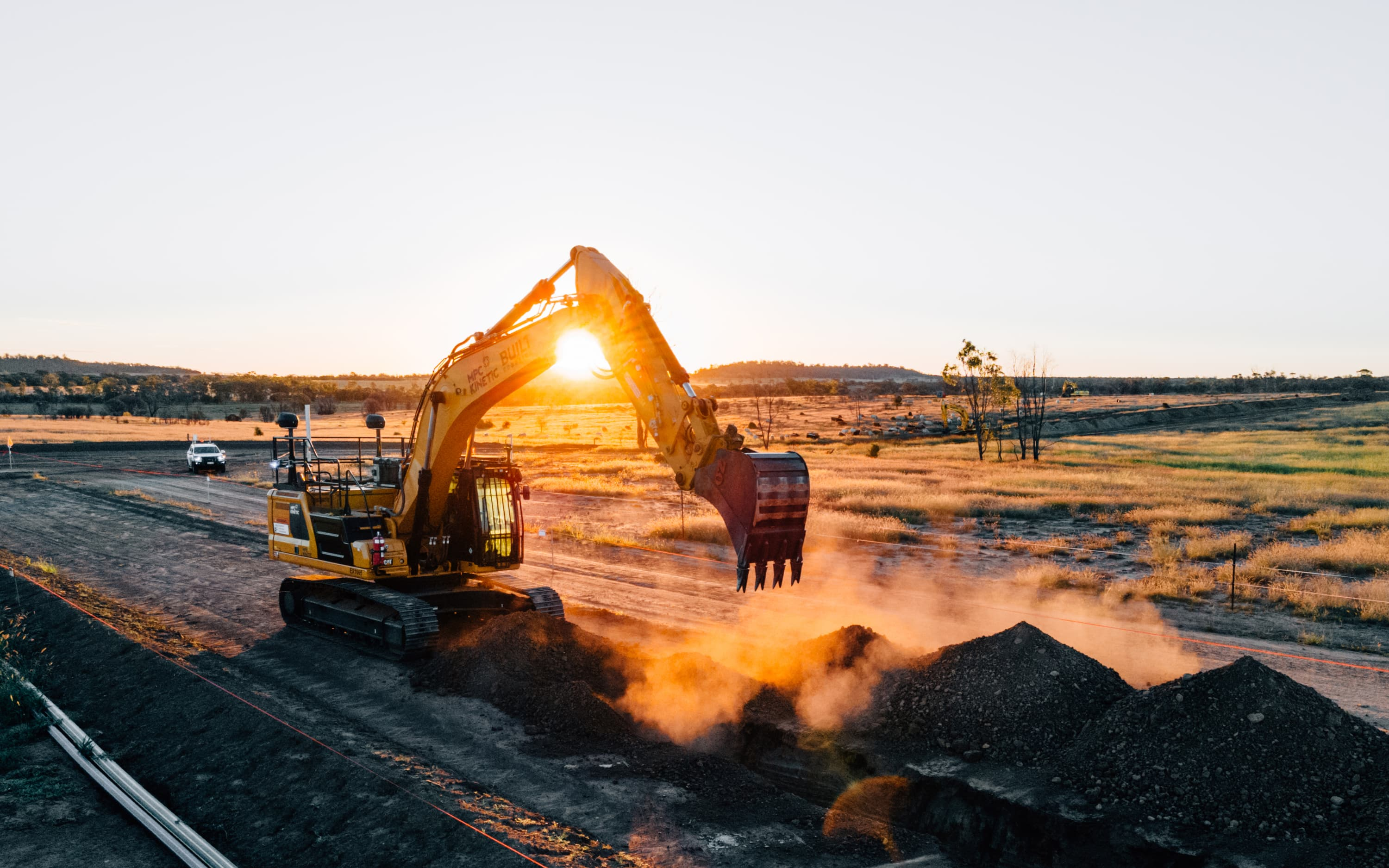 Exosystem digging trench with sunset