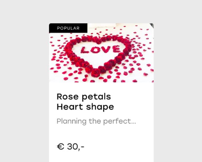Rose petals scattered heart shape 2x