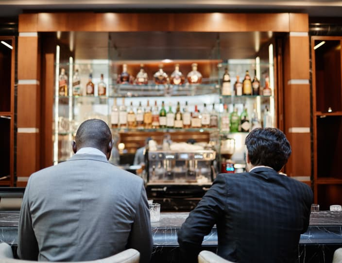 Business people at bar counter back view J26 CKPG
