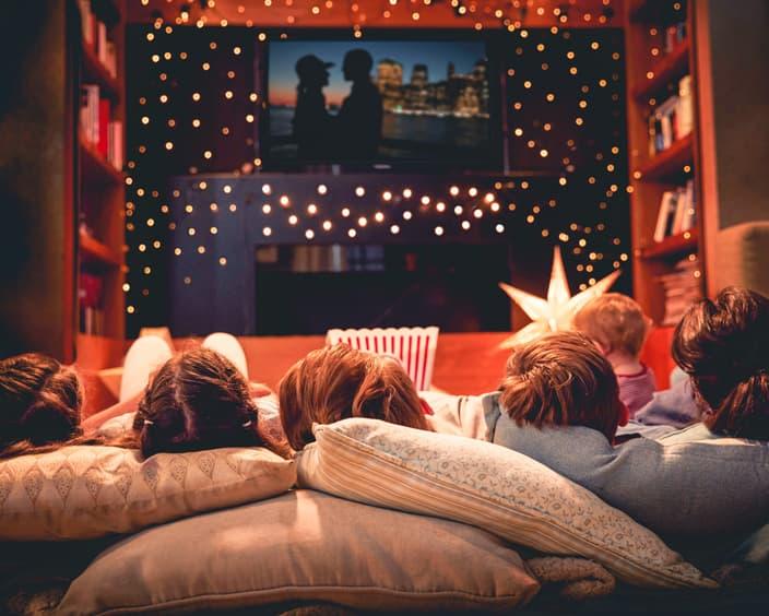 Family enjoying movie night at home together PCM5 V3 R