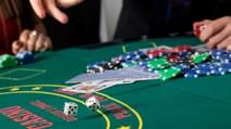 A closeup of throwing dice on a gambling table