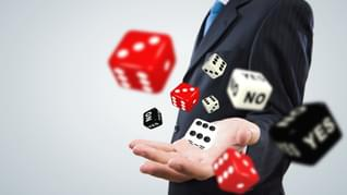 Close up of businessman throwing dice Gambling concept 1