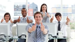 Lively business people with thumbs up in the office
