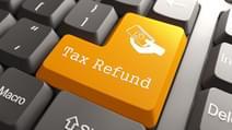 Tax Refund Orange Button on Computer Keyboard Internet Concept