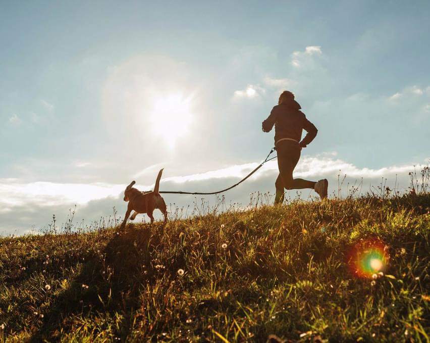 A man jogging with his dog.