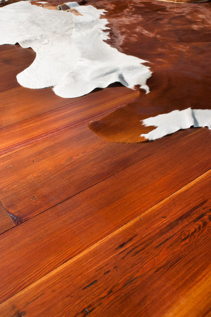 wide plank prime grade heart pine floor and animal pelts