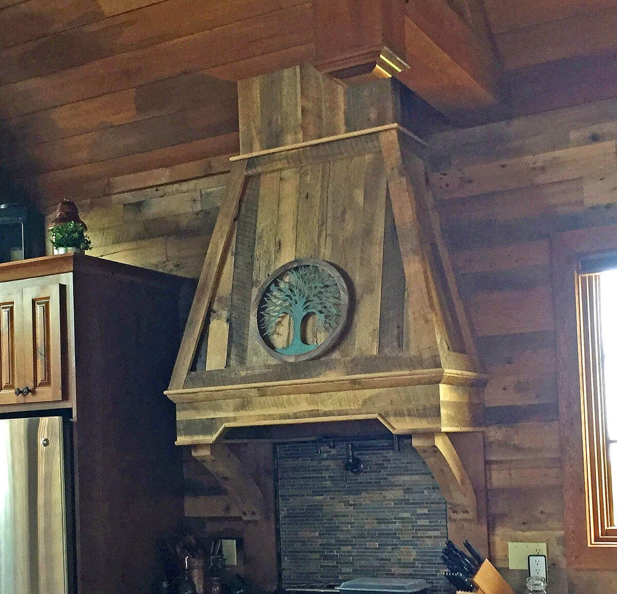 Reclaimed wood cladding on kitchen range hood at Mountain Air RV Resorts