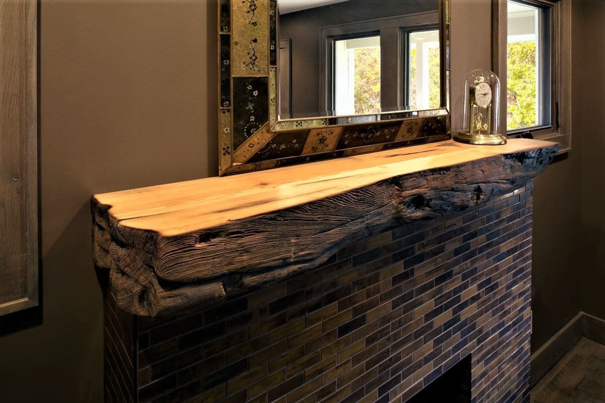 Charred heart pine mantel in Candler North Carolina home