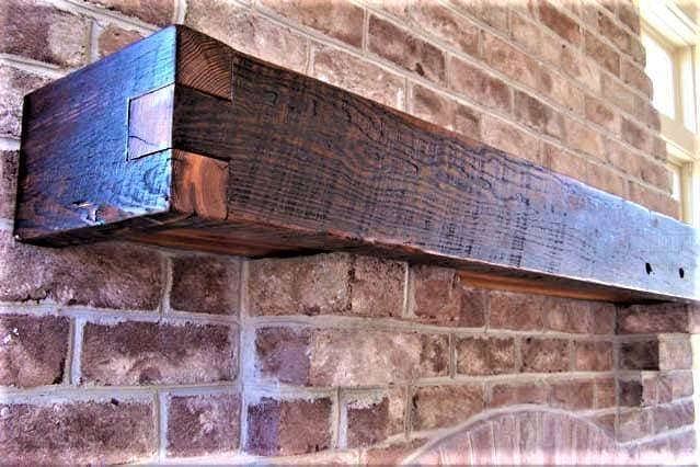 Finger Joint Heart Pine floating Box Mantel on brick wall over fireplace