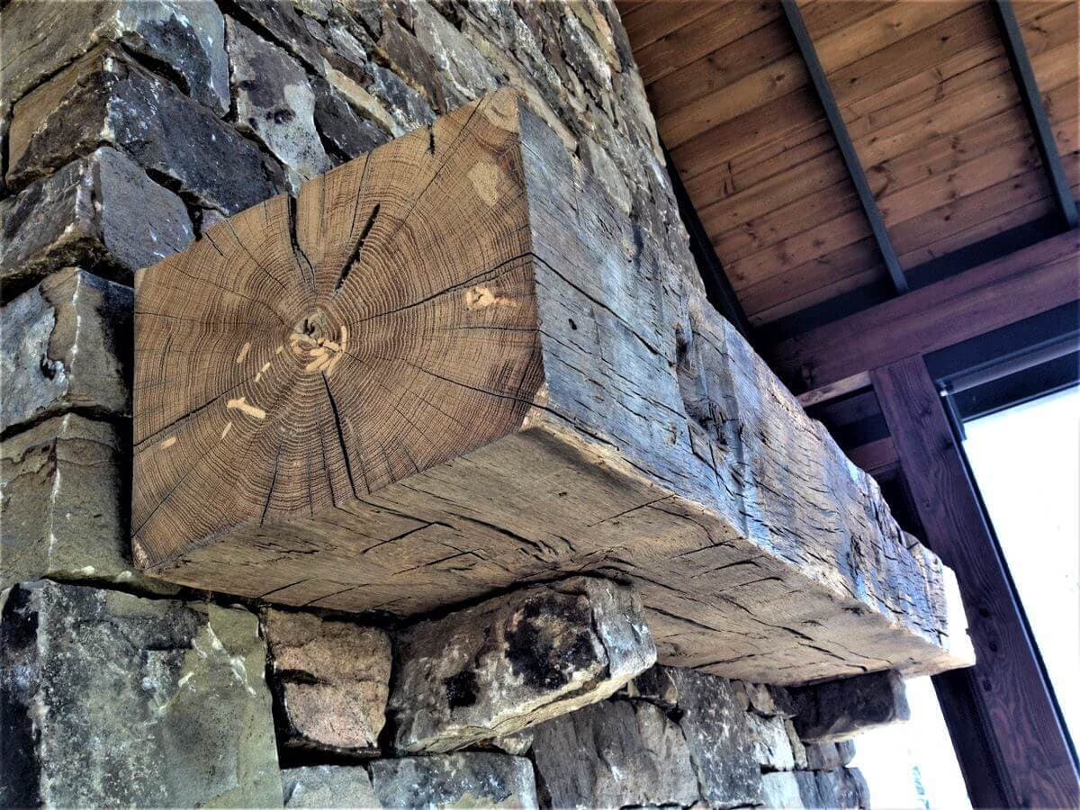 Hand hewn rustic fireplace mantel.