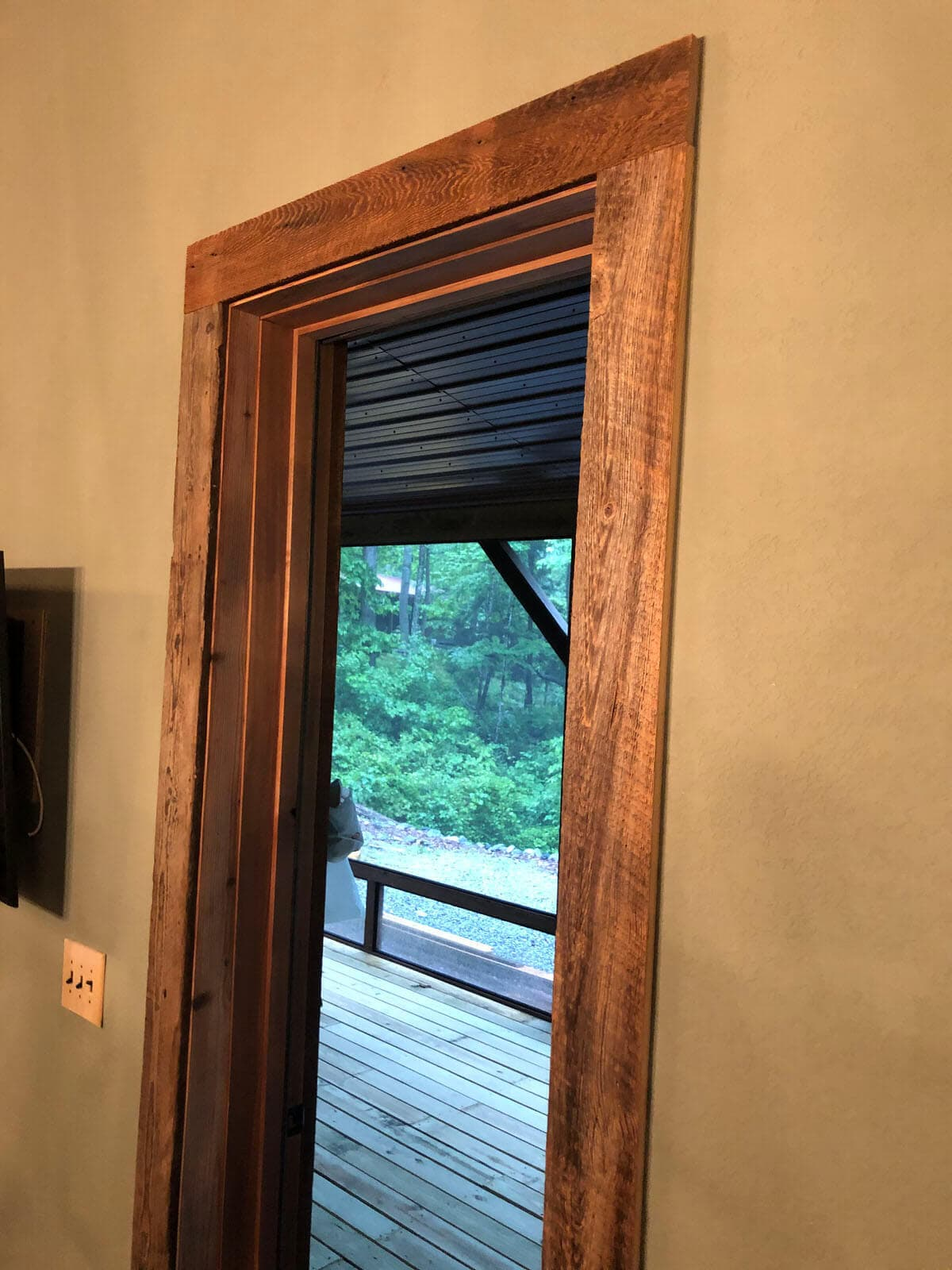 Original Surface Pine Casing around a door looking outside