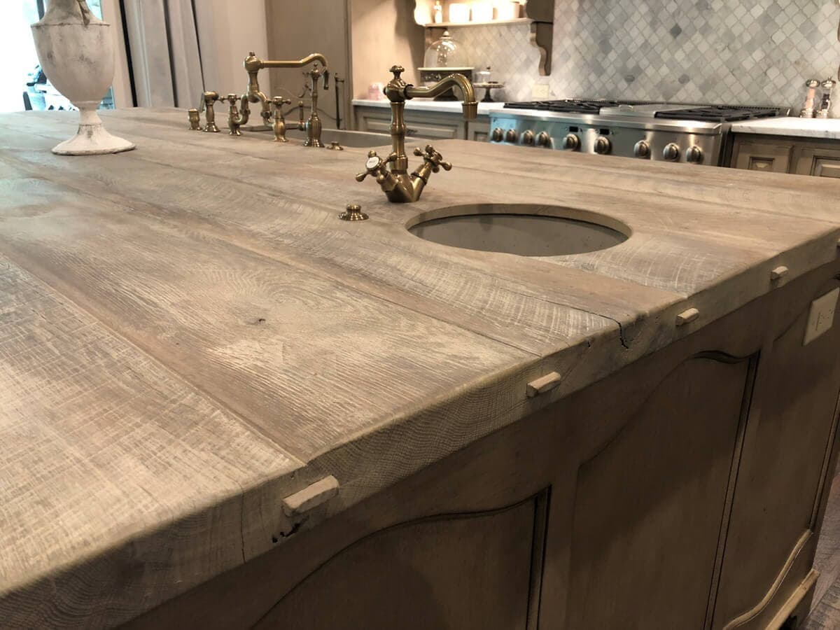 Reclaimed Counter Top side biscuit details with a sink and brass fixture