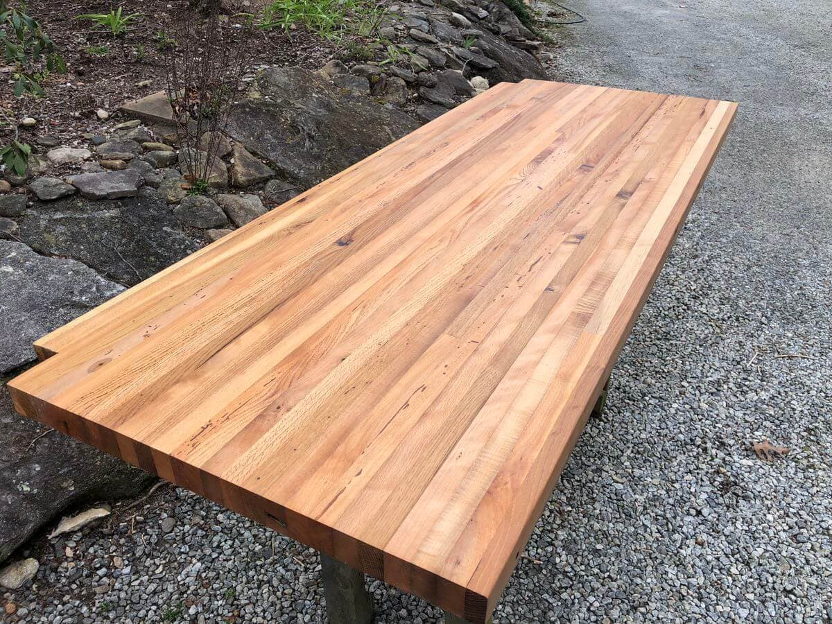 angled image of Reclaimed Mixed Hardwood Butcher Block Counter on gravel