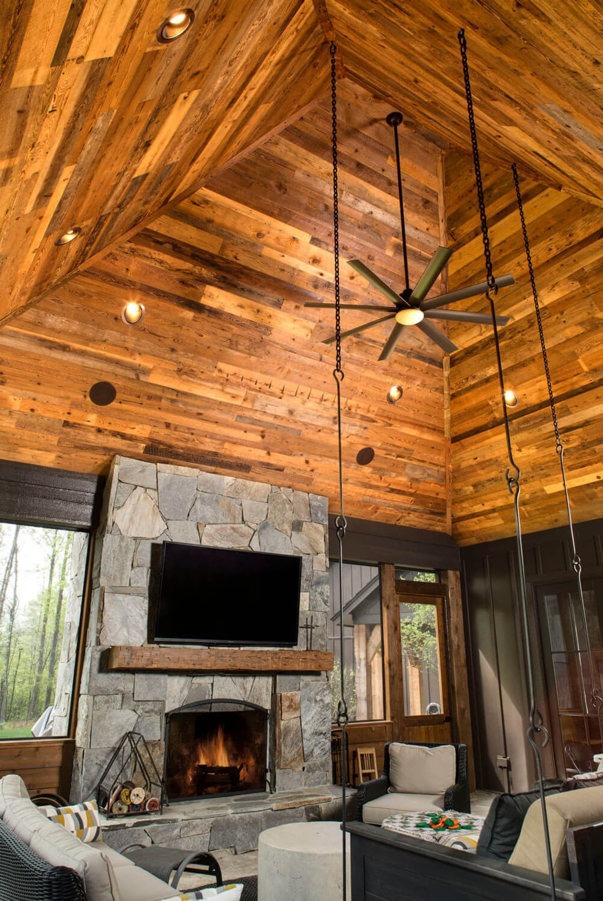 Reclaimed mixed Pine results in stunning vaulted reclaimed wood ceiling in living room.
