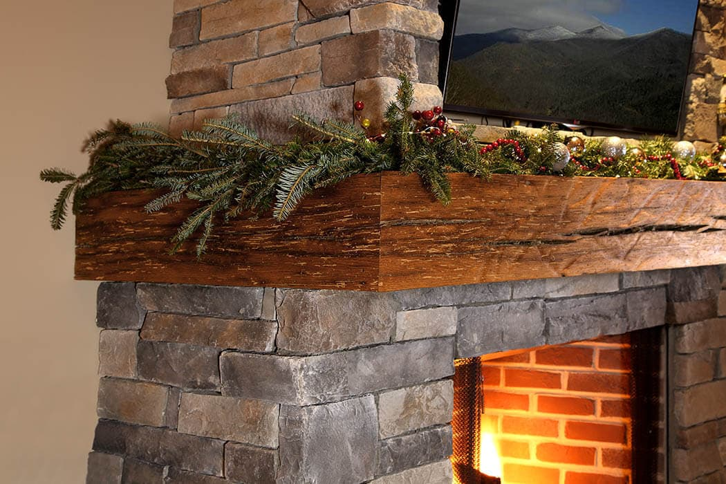 three-sided Reclaimed Oak rippled textured mantel over a brick fireplace