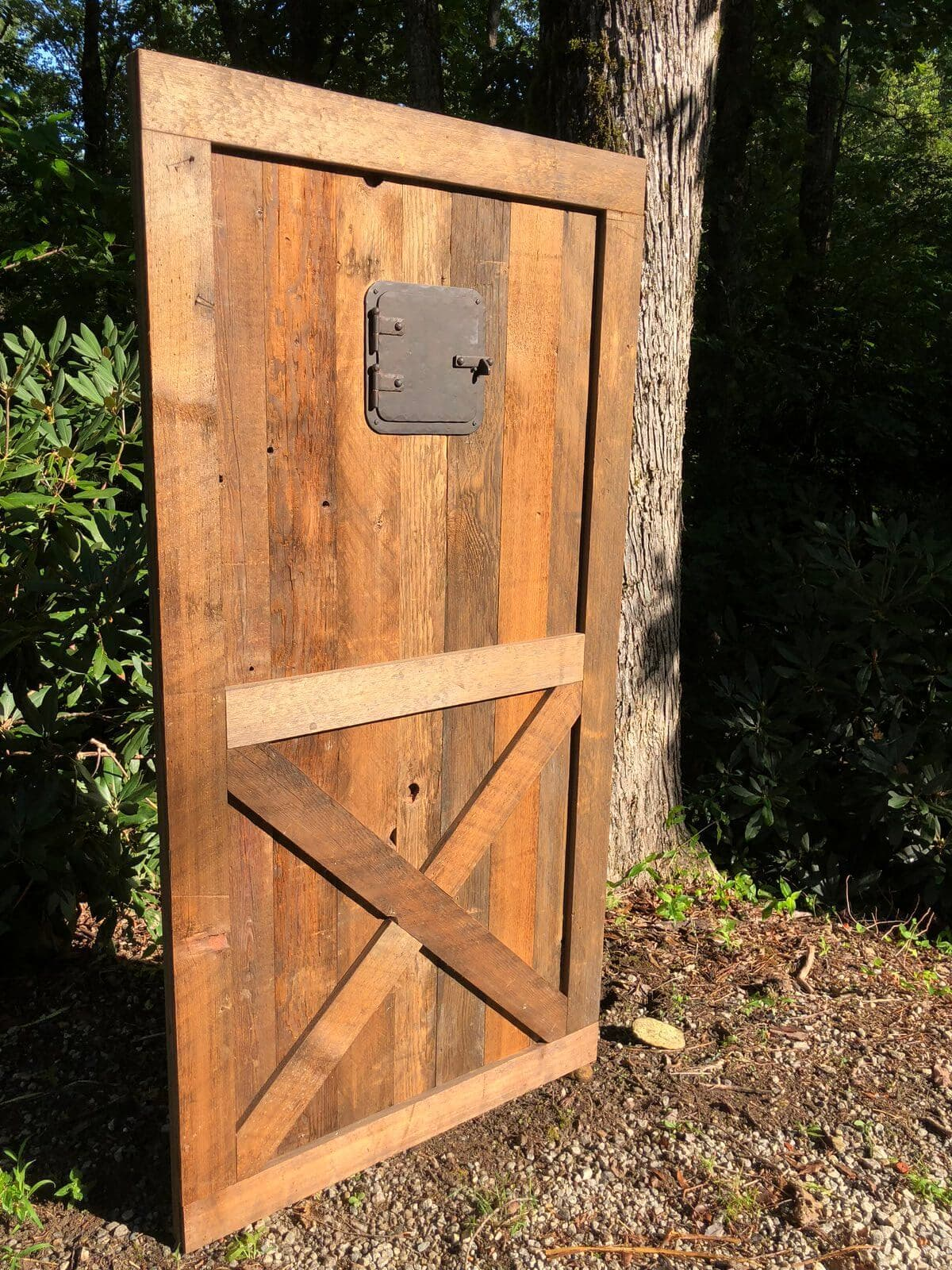 Rustic Georgia Pine Barn Door Grasse in production photo set outside