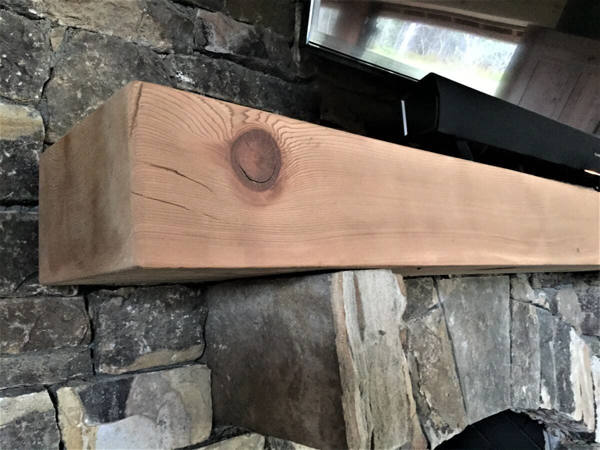 reclaimed smooth fir mantel over a fireplace and unfinished