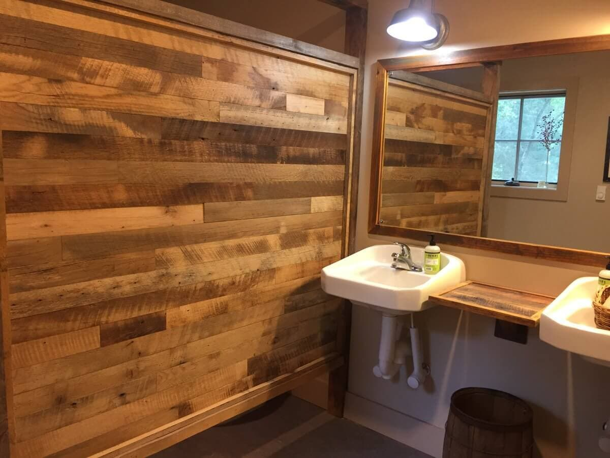 reclaimed hardwood bathroom divider next to sink and mirror
