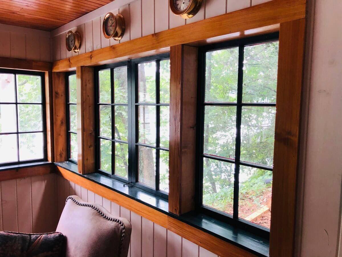 vertical grain heart pine trim boards around black rim windows in lake lure,nc
