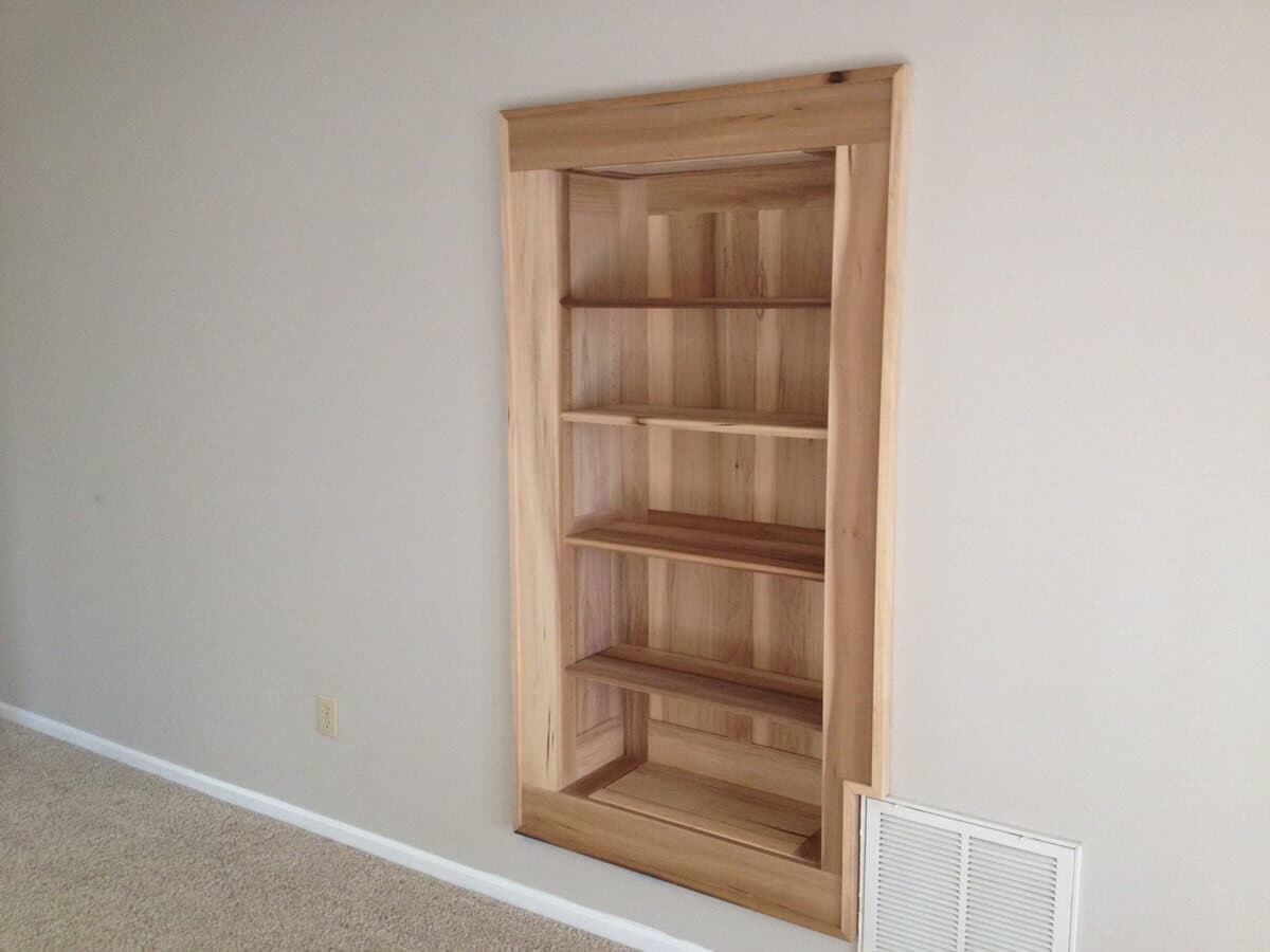 Antique cypress built in bookshelves in flat rock, nc in a bare room