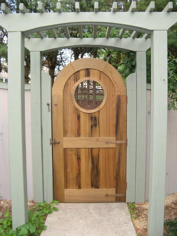 Antique cypress garden gate in a  weaverville nc home garden